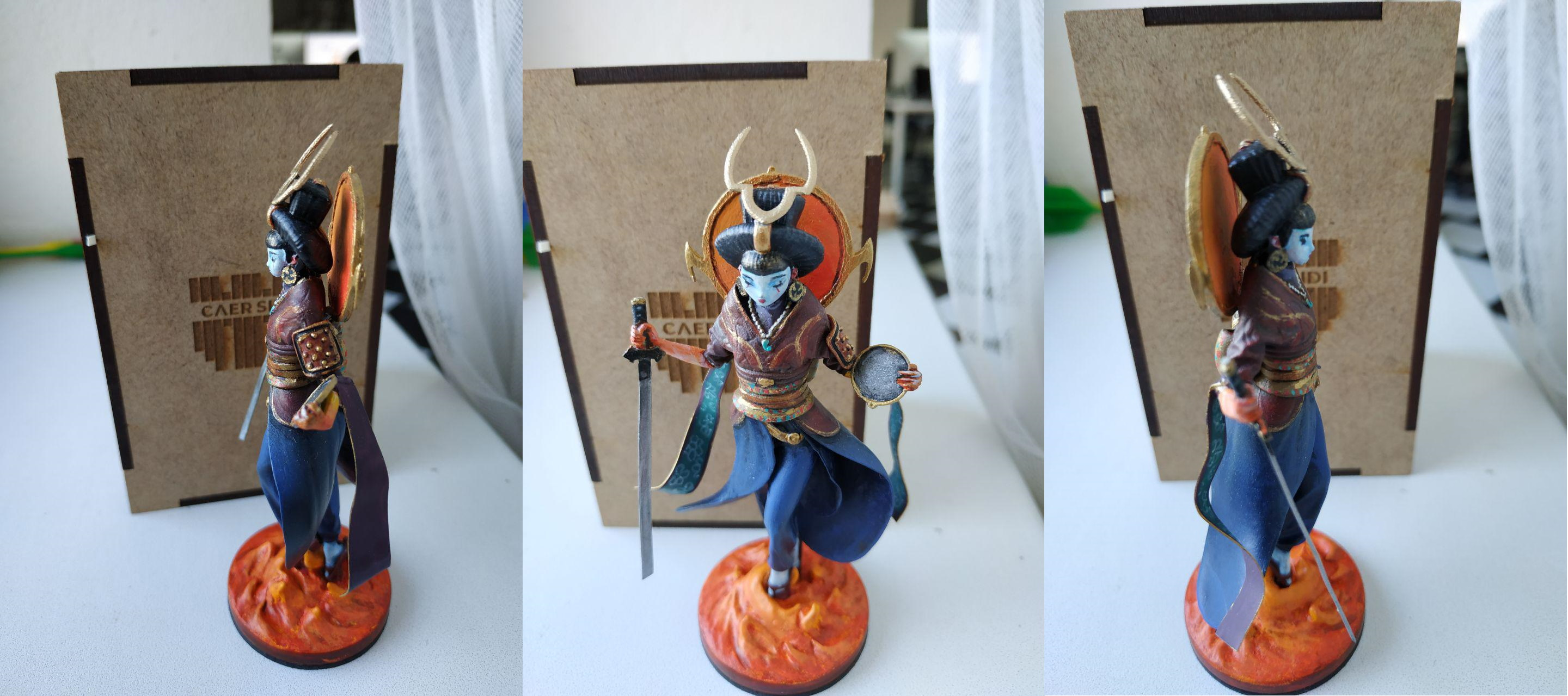 Amaterasu - a phygital figurine on Caer Sidi. It's a character from the game Altar: the War of Gods