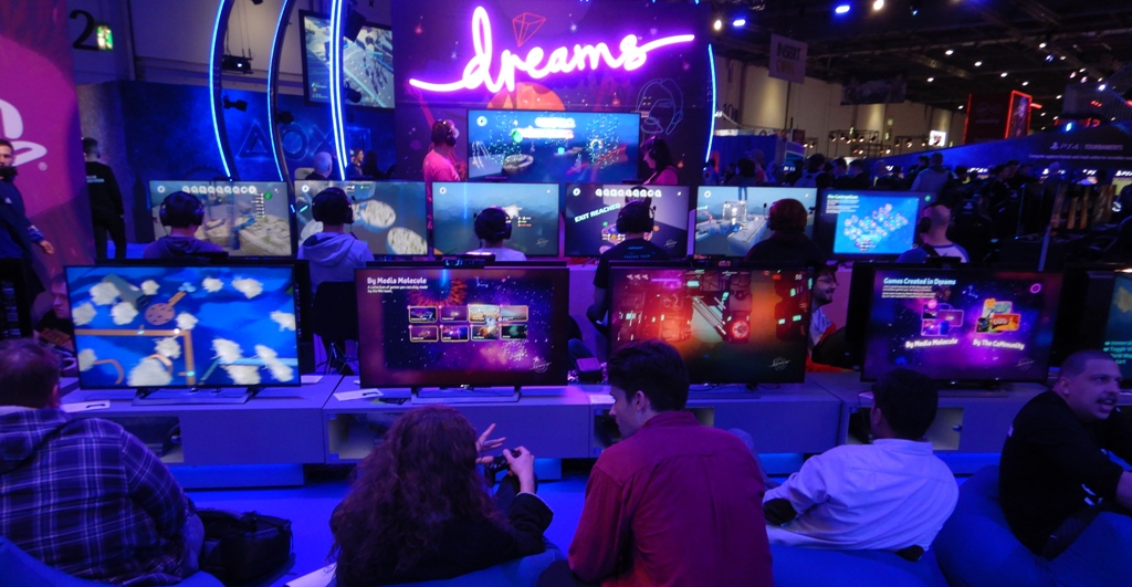 Gamers enjoy the game Dreams at EGX 2019 in London